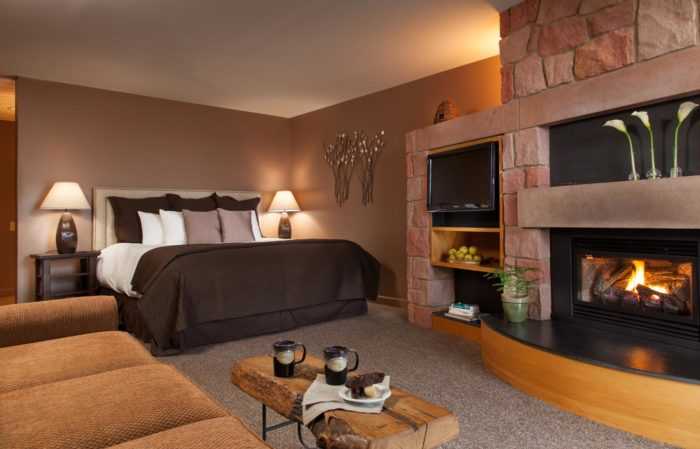 Each room features floor-to-ceiling sandstone mantles and gas fireplaces, which make the rooms extra cozy.
