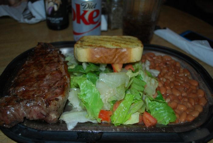 The meals here are simple. Choose your cut of steak (or a burger), and you'll get beans, salad and grilled toast.