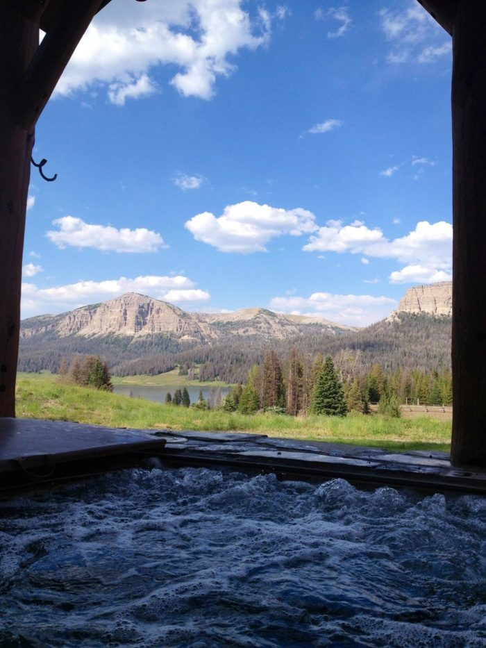 You can relax your body as you take in the gorgeous views. This covered outdoor hot tub is the largest in the Jackson Hole region. Just look at this view from the hot tub.