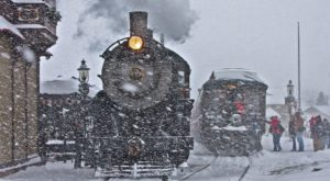 As the train pulls out of the East Strasburg Station, peer out of the window as the snow-covered landscape passes you by and...