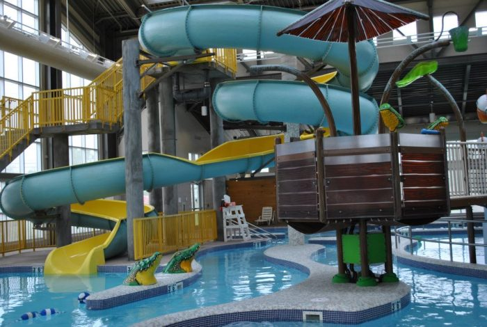 Indoor pool with waterslide  This Indoor Water Park In Mississippi Is A Must-Visit