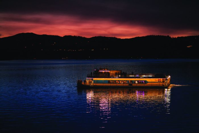 Dine in breathtaking luxury with a sunset dinner cruise on Lake Coeur d'Alene.