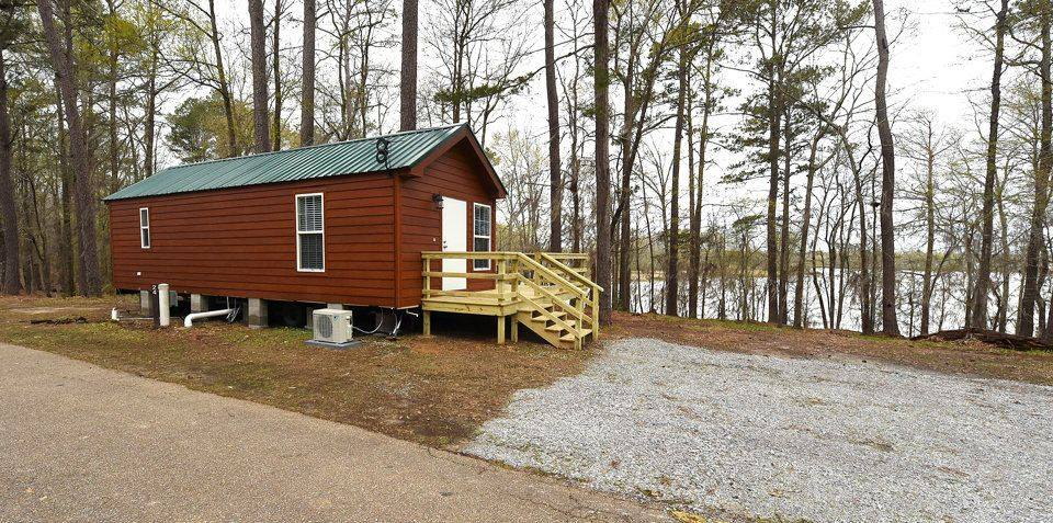Rent a tiny house cabin at roland cooper state park in for Lake cabins for rent in massachusetts