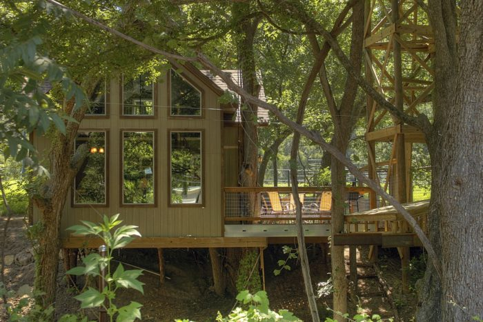 8 of the best treetop adventures to take this summer in texas for Lake cabin rentals near dallas