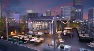 This Rooftop Bar In Denver Has A Crazy Cool View and Cozy Fire Pits