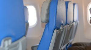 The Confusing Etiquette Of Flying In A Middle Seat And Who Really Should Get The Armrest