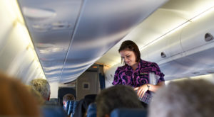 Here's Why Flight Attendants Secretly Prefer Coach Passengers
