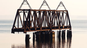 Most People Don't Know The Story Behind Maine's Abandoned Bridge To Nowhere