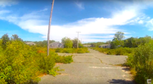 Everyone In Massachusetts Should See What's Inside The Gates Of This Abandoned 1950s Neighborhood