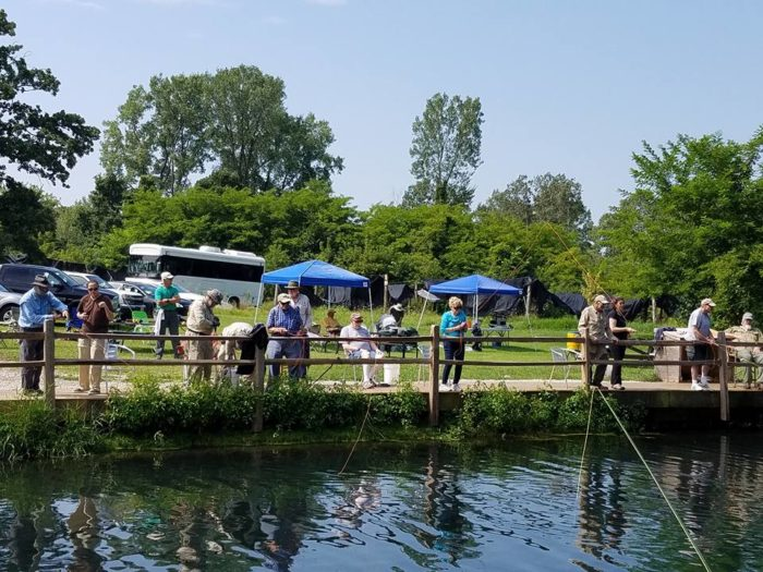 Catch your own meal at rushing waters trout farm in wisconsin for Wisconsin fishing license cost