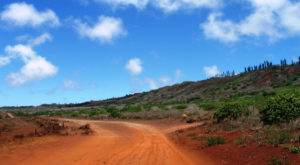 Follow The Red Dirt Road To This Untouched Hawaiian Paradise