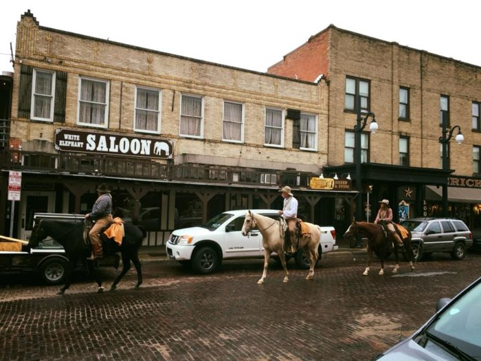 It S Not Uncommon To See Folks Ping By On Horseback Or Even Longhorn Back Fully Decked Out In Cowboy Attire Truly Doesn T Get Any More Texas