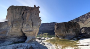 Paddle Right Up To This Brilliant Waterfall In Idaho That's Surrounded By Geologic Wonders