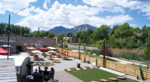 The Outdoor Beer Garden In Colorado That's Located In The Most Unforgettable Setting