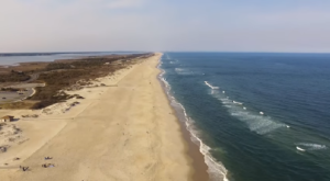 Sink Your Toes In The Sand At The Longest Beach In Maryland