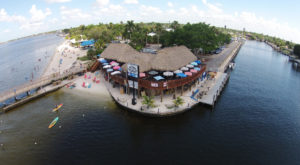 Dine At This Waterfront Tiki Hut Restaurant In Florida Where It's Summer All Year Long