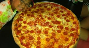 The Pizza At This Delicious South Carolina Eatery Is Bigger Than The Table
