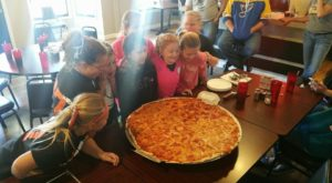 The Pizza At This Delicious Missouri Eatery Is Bigger Than The Table