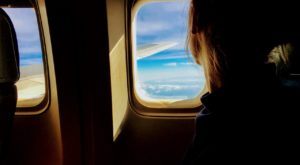 The One Thing You Should Be Doing To Relax On Planes, According To Science