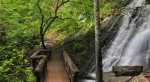 Hike To This Waterfall Fairy Tale Foot Bridge In North Carolina For A View You Can't Pass Up