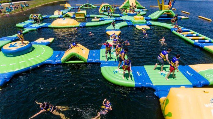 Have A Blast At The Inflatable Aqua Park At Shark Wake