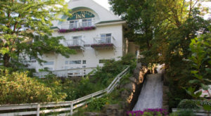 This Charming New Hampshire Restaurant Is Steps Away From A Little-Known Waterfall