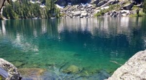This Exhilarating Hike Takes You To The Most Crystal Blue Lake In Montana
